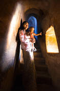 bagan,temple,burma,window,stairway,mother and child,children,culture,buddhist,buddhism,pointing,light,interior