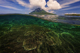 bunaken, sulawesi, underwater, over under, split view, manado, indonesia, volcano, adventure travel, diving