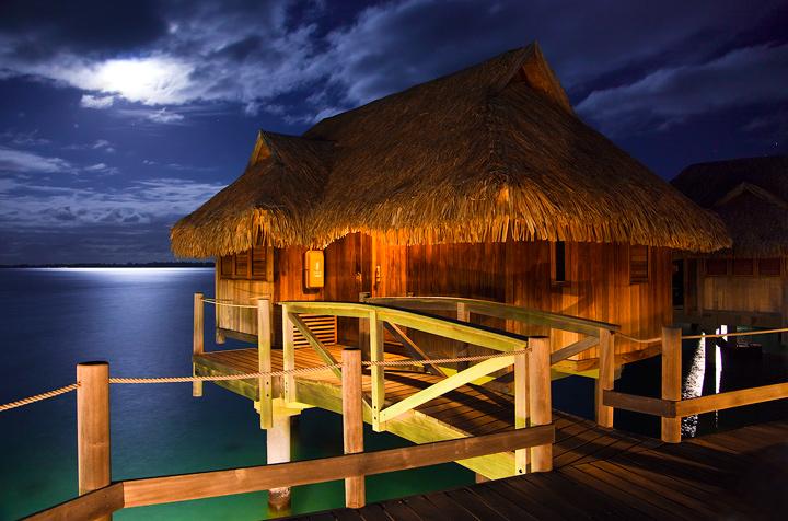The famous over-water cabanas of Bora Bora Lagoon.