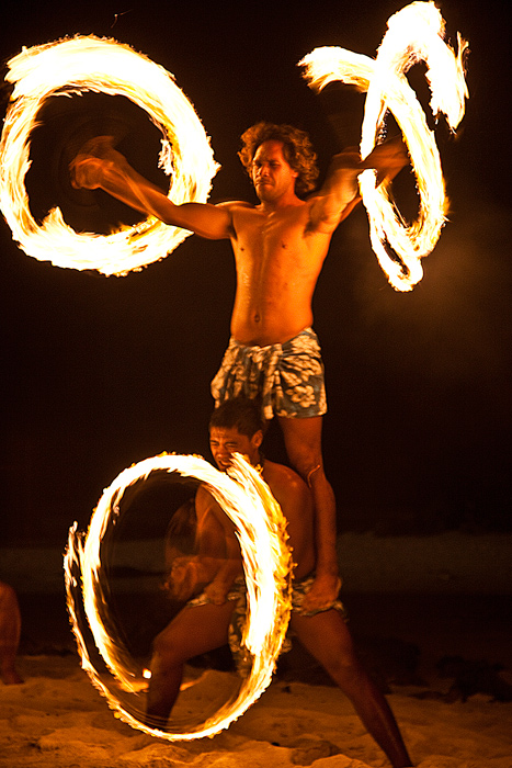 Fire dancing ona white sandbeach under a billion stars with a gentle tropical breeze and rhythmic drumming- it doesn...