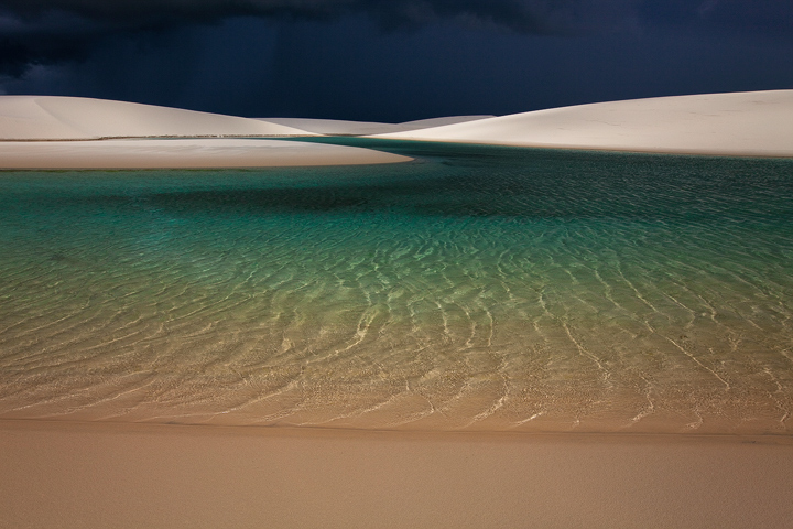 Preparing to get drenched by a powerful thunderstorm spreading over the empty dunes.