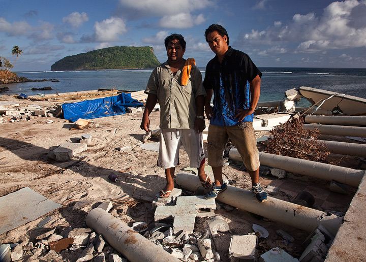 Standing over the ruins of the beachside restaurant at Litia Sini's Beach Fales, these men recall the horrifying moment the 25...