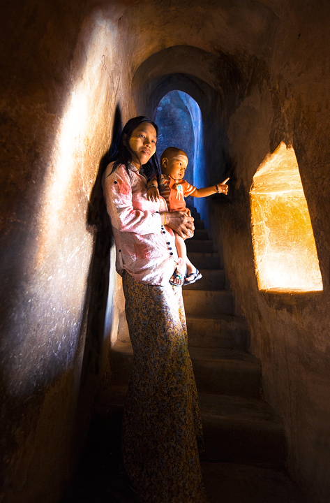 bagan,temple,burma,window,stairway,mother and child,children,culture,buddhist,buddhism,pointing,light,interior , photo